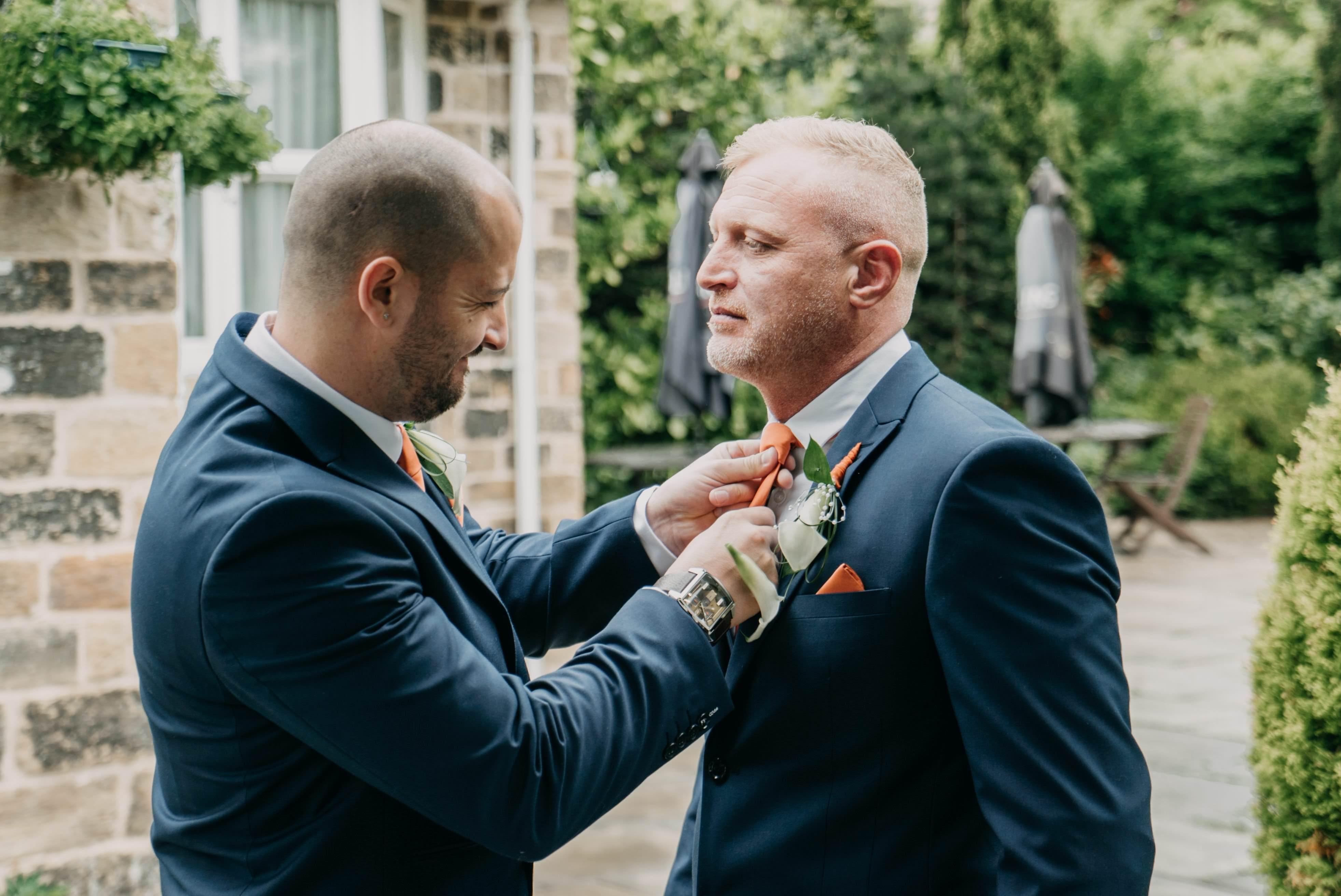 best man checking groom