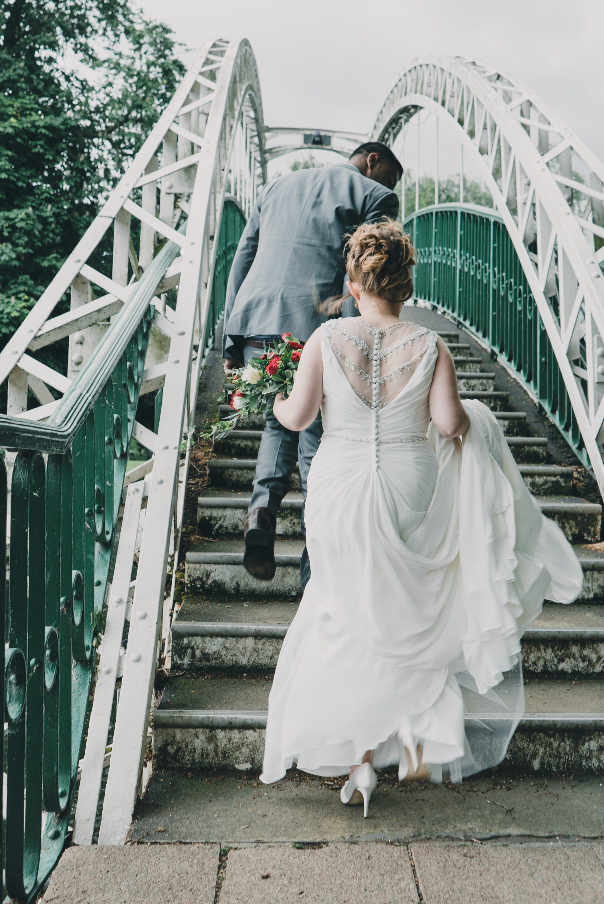 bride going up embankment stairs
