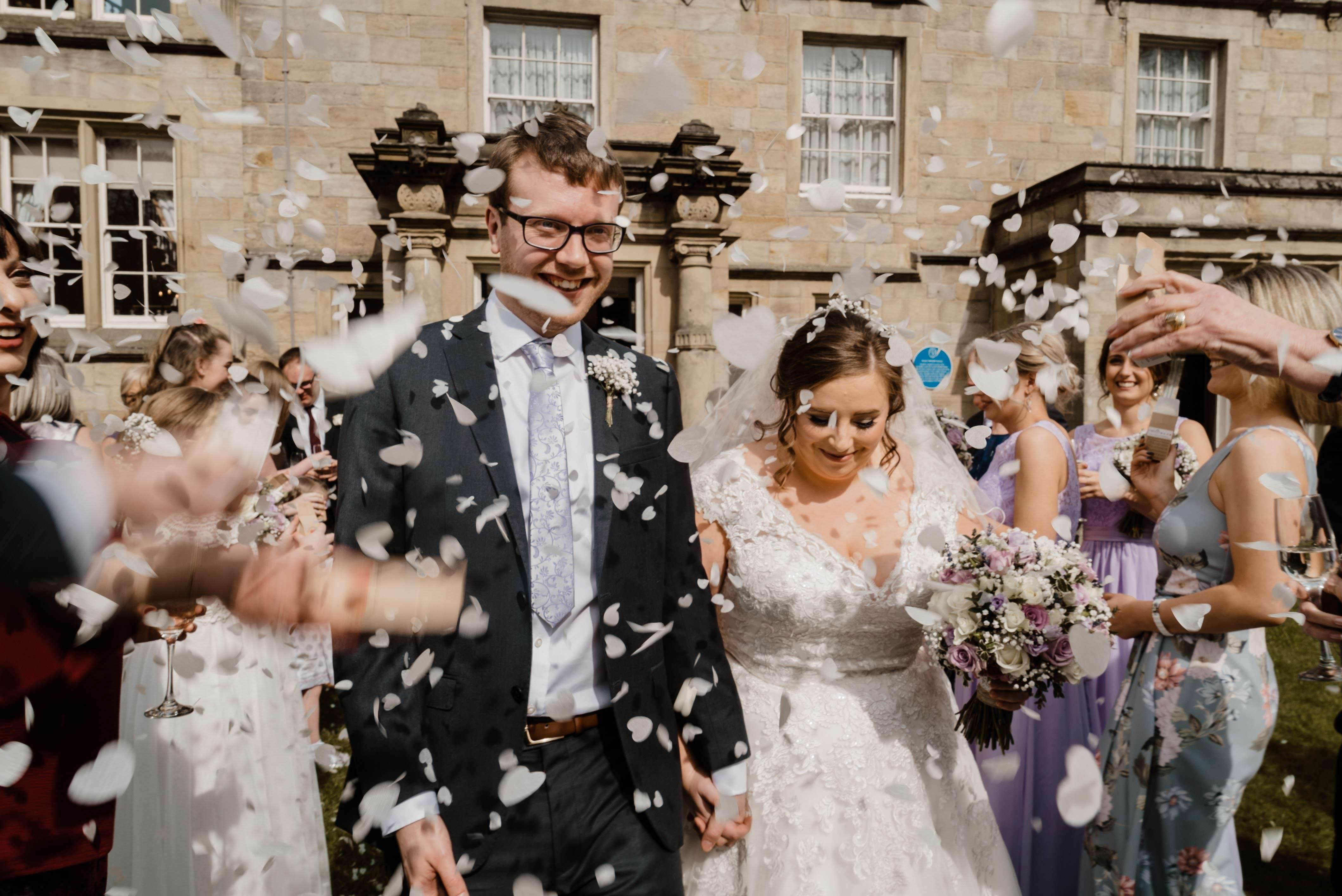 Husbadn and Bride Confetti Shot . - Weetwood Hall Wedding